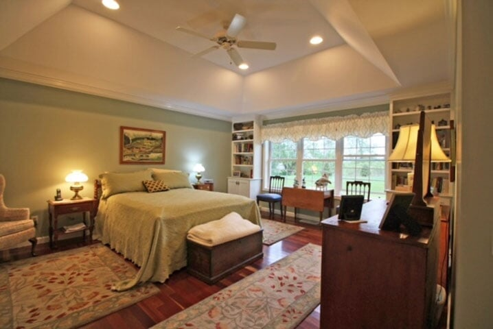 a beautiful interior painting job. Green walls in a classy bedroom